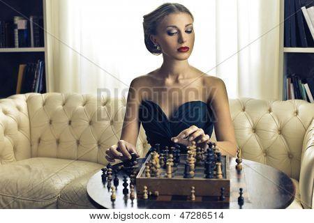 beautiful woman playing chess