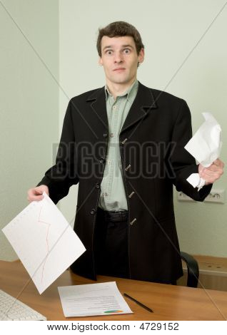 Director On A Workplace With A Crushed Paper