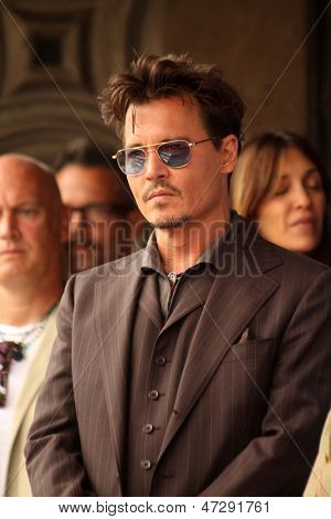 LOS ANGELES - JUN 24:  Johnny Depp at  the Jerry Bruckheimer Star on the Hollywood Walk of Fame  at the El Capitan Theater on June 24, 2013 in Los Angeles, CA