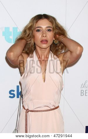 LOS ANGELES - JUN 25:  Olesya Rulin arrives at the 4th Annual Thirst Gala at the Beverly Hilton Hotel on June 25, 2013 in Beverly Hills, CA
