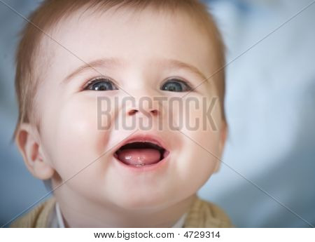 Portrait Of Happy Blue-eyes Baby
