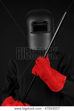Portrait of  welder in mask, isolated on black