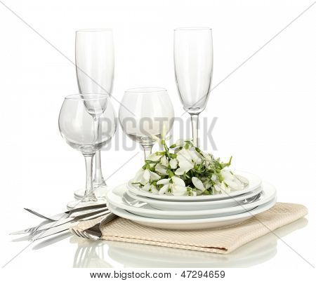 Serving dishes and snowdrops isolated on white