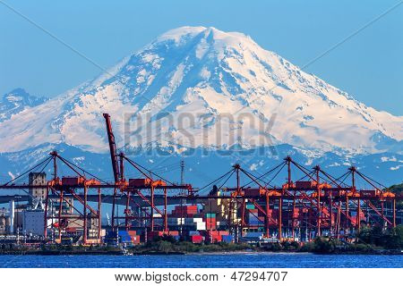 Seattle Port With Red Cranes And Boats With Mt Rainier In The Background