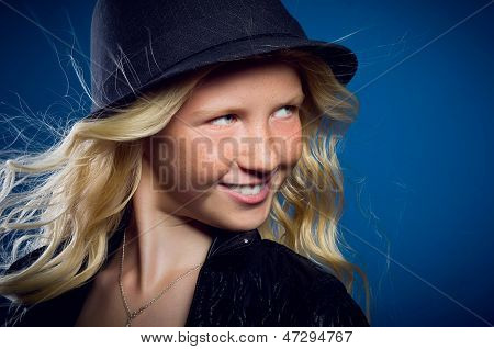 Cheerful Little Girl Smiles And Looks Away Fervently
