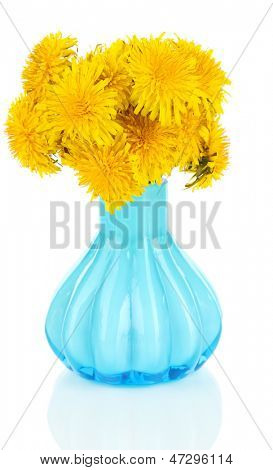 Dandelion flowers in vase isolated on white