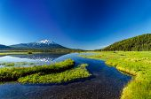 pic of bend  - Mount Bachelor being reflected in Sparks Lake as seen from a meadow near Bend Oregon - JPG