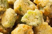 foto of okras  - Organic Homemade Fried Green Okra against a Background - JPG