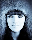 Winter Portrait Of Young Beautiful Woman In Furry Hat poster