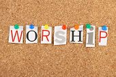 image of adoration  - The word Worship in cut out magazine letters pinned to a cork notice board - JPG