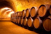 stock photo of basement  - Antique Wine Cellar with Rusty Wooden Barrels - JPG
