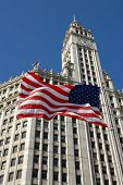 American Flag In Front Of Wrigley Building Chicago, Illinois poster