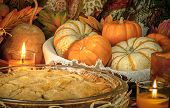 stock photo of pumpkin pie  - Pumpkins and cake on candle light still life - JPG