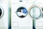 stock photo of dirty-laundry  - laundry with washing machines side by side - JPG
