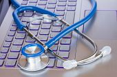 stock photo of stethoscope  - stethoscope on laptop keyboard  - JPG