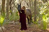 picture of bareback  - medieval woman in dress with horse in forest - JPG