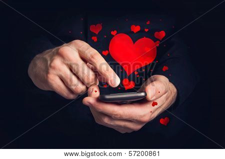 Man Typing Love Text Messages On A Smartphone For Valentine's Day
