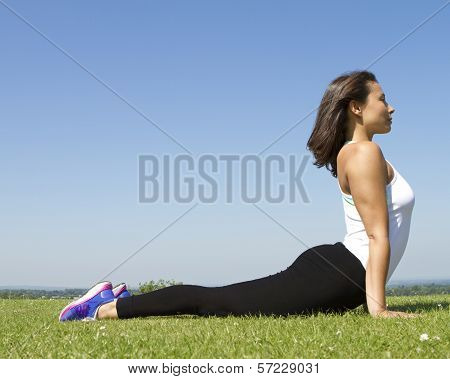 Young woman in yoga cobra pose