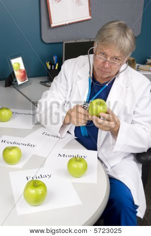 Doctor Examines An Apple