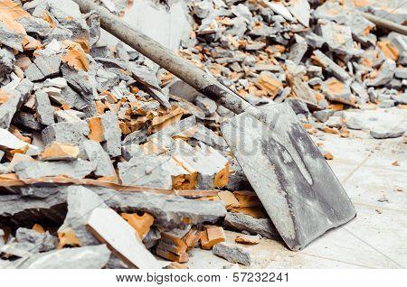 shovel with brickbat
