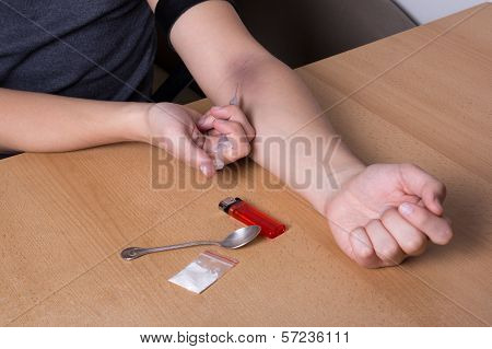 Close Up Of Man Injecting Heroin