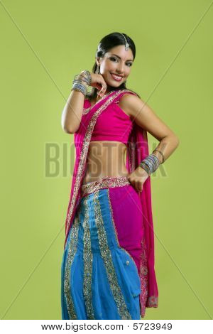 Beautiful indian young brunette woman dancing