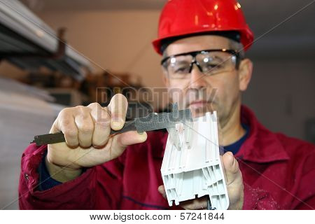 Worker Using A Vernier Caliper
