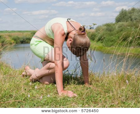 Young Girl Doing Yoga Against Nature