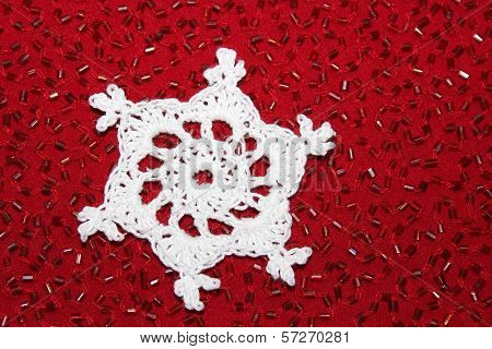 Crochet Snowflake with Red Bead Background