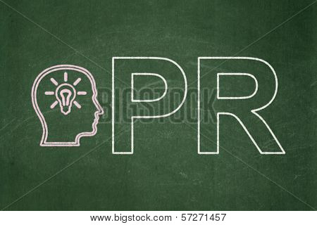 Advertising concept: Head With Lightbulb and PR on chalkboard background