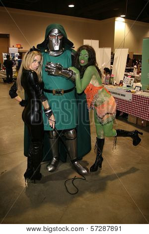 Paula Labaredas and Alicia Arden from CelebrityCosplay.com with Dr. Doom at Long Beach Comic-Con Day 2, Long Beach Convention Center, Long Beach, CA. 10-30-10
