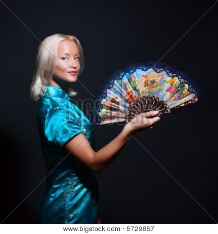 Portrait Of A Beautiful Young Woman With Fan