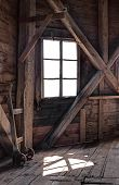 pic of chalet interior  - Interior of an abandoned wooden house with light coming through the window - JPG