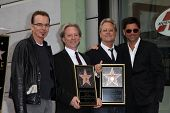 Billy Bob Thornton, Dewey Bunnell, Gerry Beckley, John Stamos at the America Star on the Walk of Fam