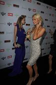 Tamara Braun photo op interrupted by Paris Hilton at the EMI Music 2012 Grammy Awards Party, Capital