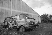 stock photo of forlorn  - old and rusted car wrecks in black and white - JPG