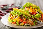 pic of tacos  - plate of taco on a wooden table - JPG