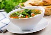 stock photo of vegetable soup  - bowl of vegetable soup with green parsley - JPG