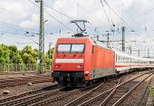 pic of koln  - Electric locomotive with passenger train on Cologne station Germany - JPG