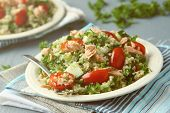 stock photo of tabouleh  - Tabbouleh salad with quinoa salmon tomatoes cucumbers and parsley - JPG