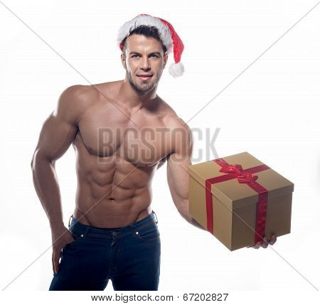 Muscular, sexy santa claus with gift