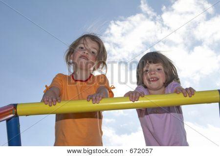 Twins On Climbing Pole