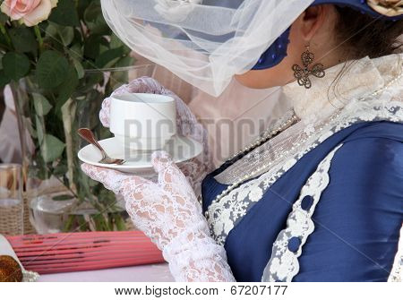 Beautiful rich women with cup of tea in retro style