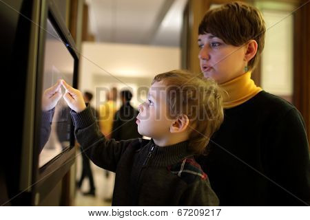 Family Playing With Touch Screen