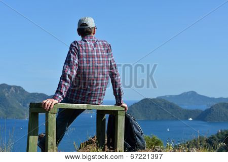 Tourist on the bench against Marmaris bay