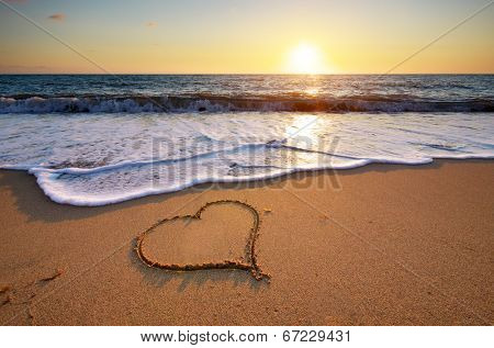 Heart on beach. Romantic composition.