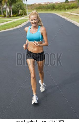 Beautiful Blond Woman Running And Listening To Mp3 Player