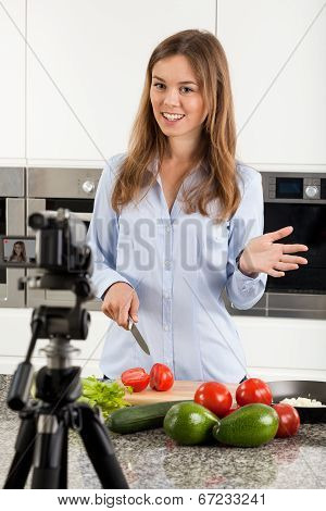 Woman Filming Her Meal Preparation