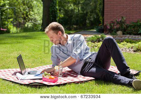 Businessman Working In The Garden