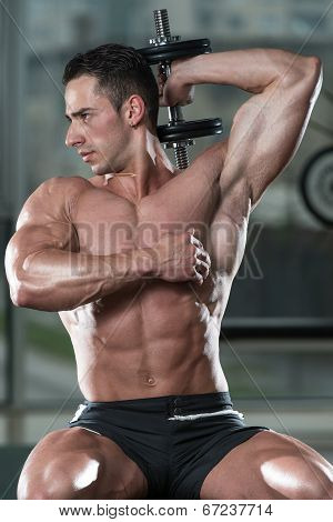 Bodybuilder Exercising Triceps With Dumbbells